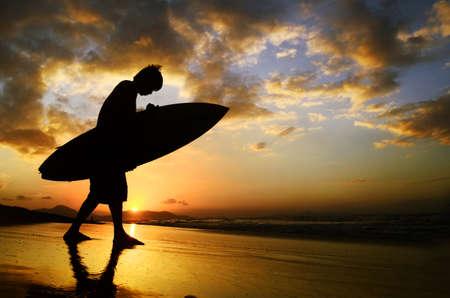 Silhouette of the surfer man Banco de Imagens