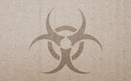 stratum: A biohazard symbol on a carton background. Stock Photo