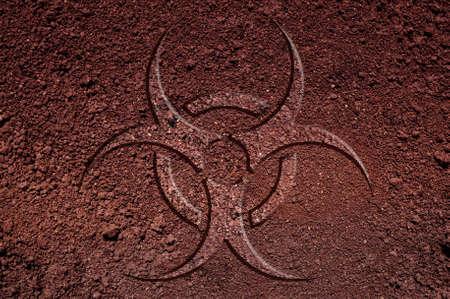 A biohazard symbol made of soil. An ecological concept.