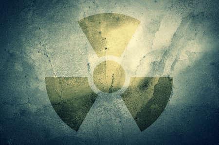 fallout: A radiation warning symbol on a grunge background. Stock Photo