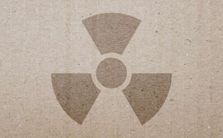 fallout: A radiation warning symbol on a carton background. Stock Photo