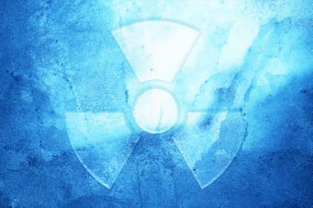 A radiation warning symbol on an ice background.