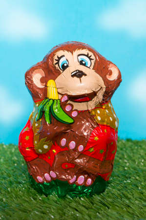 wrapper: Chocolate monkey in a wrapper Stock Photo