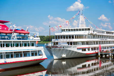 uglich russia: UGLICH, RUSSIA - JULY 03, 2016: Two cruise ships Konstantin Fedin and Viking Akun are at the pier of Uglich. Uglich is a historic town in Yaroslavl Oblast, Russia, which stands on the Volga River. Editorial