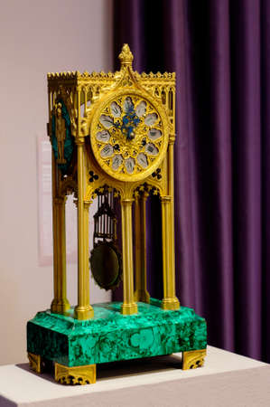 antiqued: YAROSLAVL, RUSSIA - JUNE 30, 2016: A mantel clock in gothic style made in Western Europe in the end the XIX century. The mantel clock is located in The Foreign Art Museum in Yaroslavl.