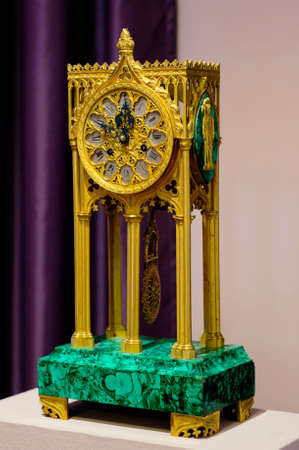 YAROSLAVL, RUSSIA - JUNE 30, 2016: A mantel clock in gothic style made in Western Europe in the end the XIX century. The mantel clock is located in The Foreign Art Museum in Yaroslavl.