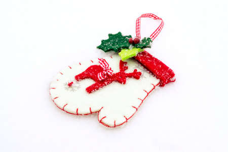A christmas background with a christmas glove on snow. Stock Photo