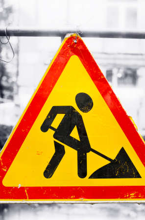 A close-up photo of a road sign Under Construction.