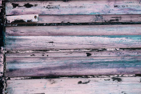 roughly: A grungy aged wooden wall background.