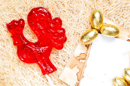 sugarplum: A red rooster lollipop with golden eggs background. The rooster is a symbol of 2017 and a sign of the Chinese horoscope.
