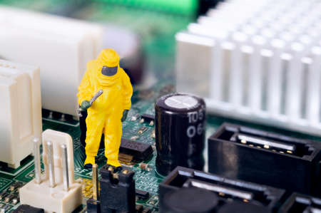 A toy technician is repairing and diagnosing a motherboard. Stock Photo