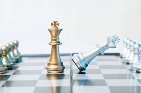 A conceptual photo with chess pieces on a chessboard. Business, law or political concept, which could represent the war of corporations, geopolitical situation and so on. Selective focus.