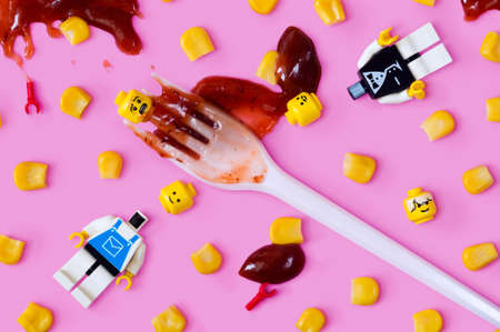 MAGNITOGORSK, RUSSIA - February 23, 2018: a group of LEGO figurines with corn and tomato sause. Illustrative editorial. Editorial