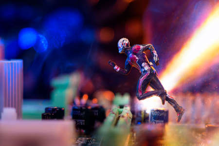 MAGNITOGORSK, RUSSIA - March 12, 2018: A figurine of running Ant-Man hero. Ant-Man is the name of a fictional character appearing in comic books published by Marvel Comics. Illustrative editorial. Editorial