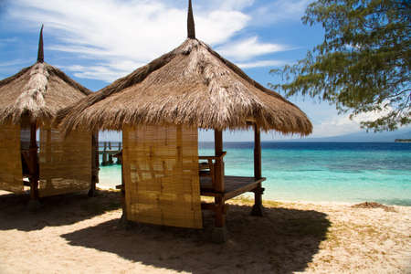 cabana: Hut at beach and turquoise sea on island, Gili Islands Stock Photo