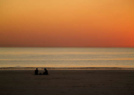 Romantic Sunset at Beach, Broome, Australia, stunning, orange yellow sky, no clouds  Stock Photo - 13554266
