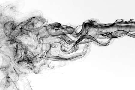 Dark smoke with beautiful shape  in front of white background photo