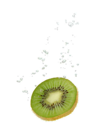 Kiwi fruit falling into water, with air bubbles, in front of white background, union of the three things essential to live which is air, water and nutrition photo