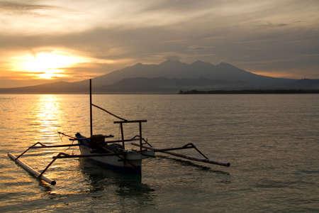 Sunrise above volcano Rinjani with fishing boat, Lombok photo