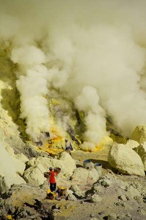 sulfur: Workers mining sulfur inside volcano Ijen Stock Photo