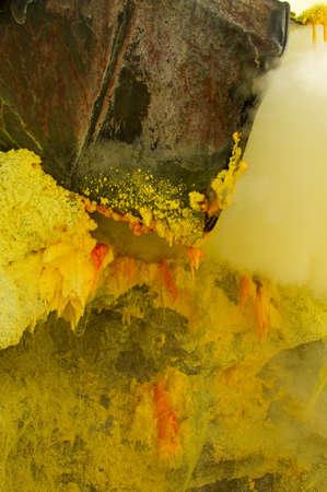 Crystal of sulfur in mine inside Ijen volcano photo