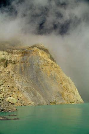 sulfur: Yellow sulfur mine with blue lake inside volcano, Ijen Plateau