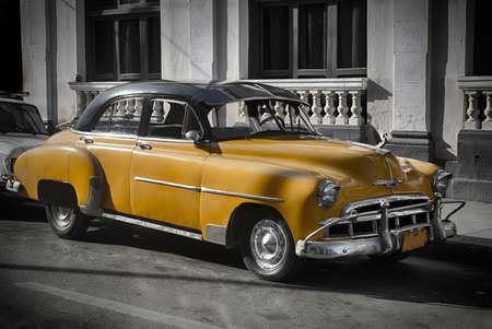 Old car in Cuba, Havanna, yellow colourized