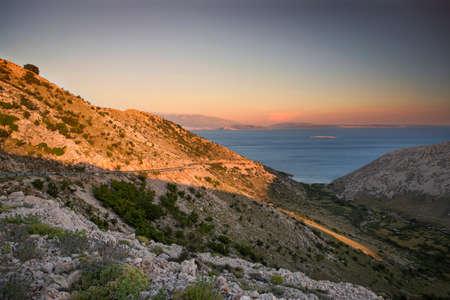 krk: Coast during sunset in Krk, Croatia Stock Photo