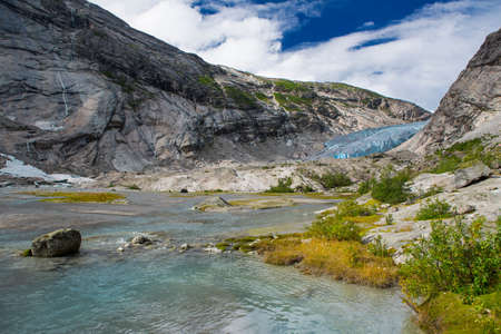 jostedal: Blue glacier with lake Nigardsbreen in Norway