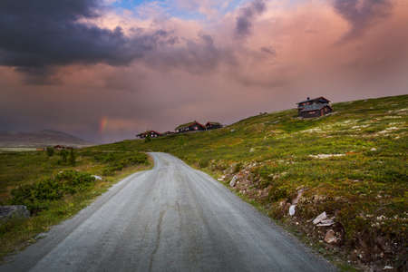 huts: Huts in landscape of Norway during sunset