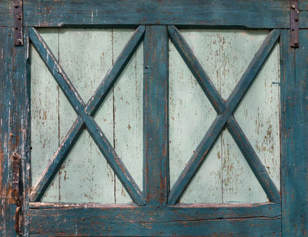 Old green turquoise colored wood door