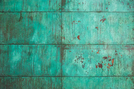 Weathered, oxidized copper wall structure in green Banco de Imagens