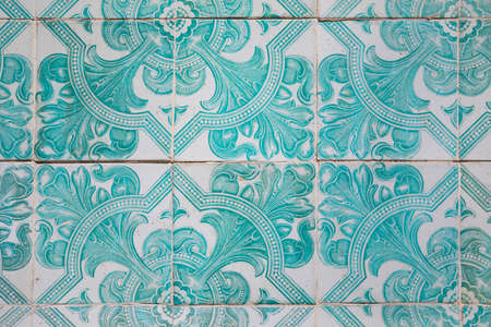 Old tile wall in Portugal in turquoise colored pattern