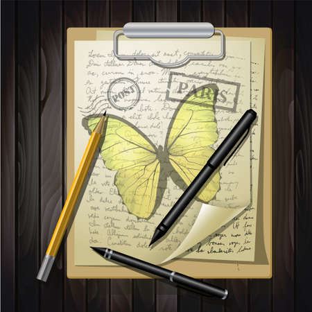 yellow butterfly: table top with sketching paper and yellow butterfly on hand-drawn writing background with  eiffel tower