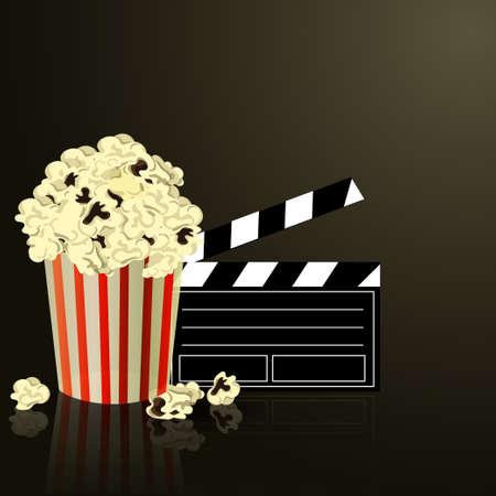 Popcorn and movie clapper board on dark background
