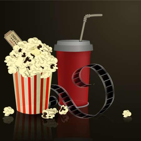 Popcorn and movie film on dark background