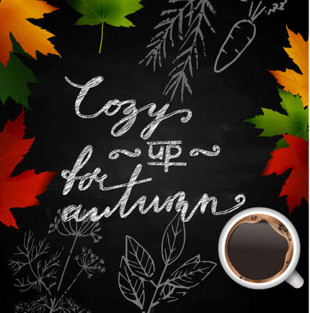 Chalkboard with autumn leaves and cup of coffee