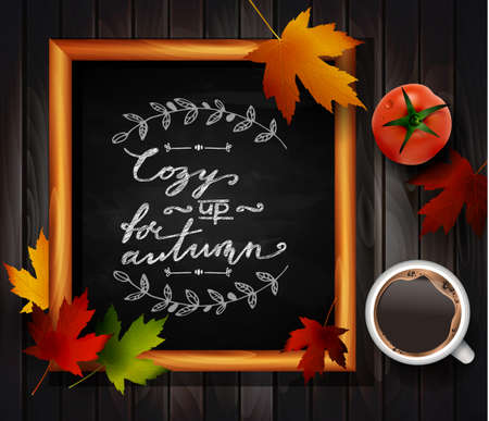 Chalkboard with autumn leaves and cup of coffee and tomato