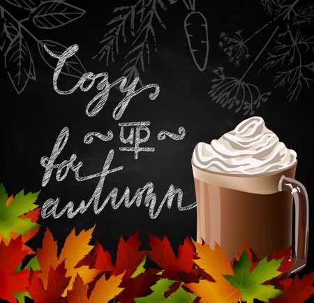 Tafel mit Herbstlaub und eine Tasse heiße Schokolade