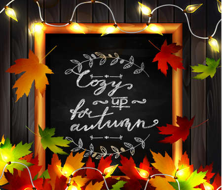 Chalkboard with autumn leaves a cozy lights and falling leaves