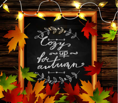 rural area: Chalkboard with autumn leaves a cozy lights and falling leaves