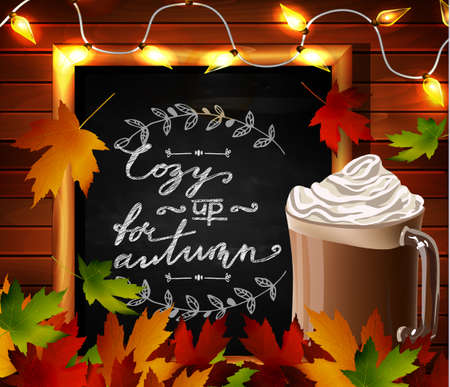 cozy: Chalkboard with autumn leaves and cup Hot chocolate and cozy lights