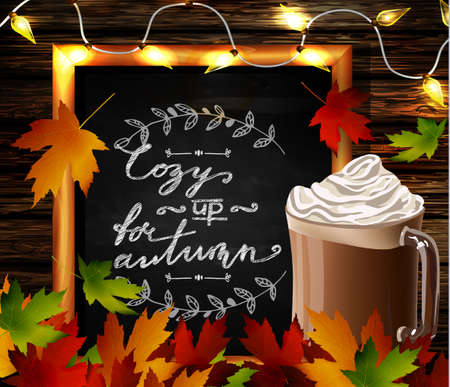 hot chocolate: Chalkboard with autumn leaves and cup Hot chocolate and cozy lights