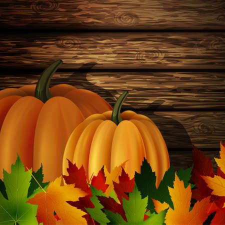 autumn leaves and two orange pumpkins on wooden texture. Could be used for your Thanksgiving greetings