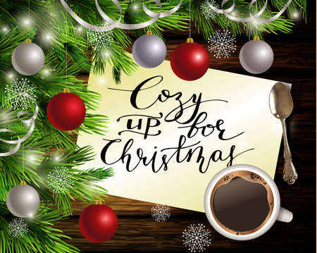Christmas New Year design dark wooden background with christmas tree and silver and red balls and handwritten Cozy up for Christmas coffee and teaspoon