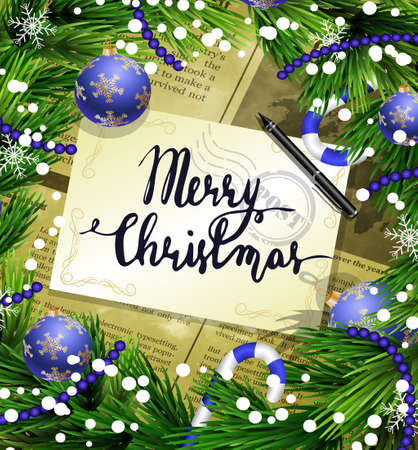 Christmas New Year design old newspaper background with christmas decorations candy canes snow and balls arranged in a frame with handwritten Merry Christmas and a pen in blue.