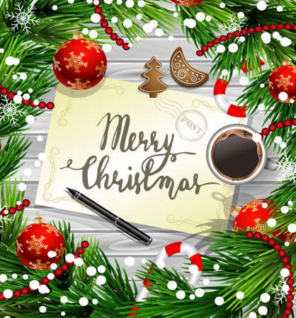 Christmas New Year design wooden background with christmas decorations candy canes snow and balls arranged in a frame with handwritten Merry CHristmas a cup of coffee gingerbread cookies and a pen in red.