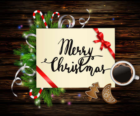 Christmas background with paper ribbon and lights on a wooden wall with free space and cup of coffee and gingerbread cookies and with handwritten Merry Christmas.