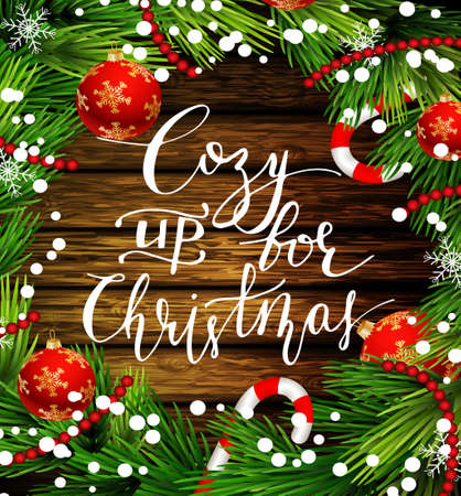Christmas New Year design wooden background with christmas decorations candy canes snow and balls arranged in a frame and with handwritten Cozy up for Christmas Stock Vector - 66786260