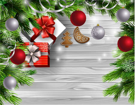 Christmas New Year design light wooden background with christmas tree and silver and red balls and gingerbread cookies with gift boxes